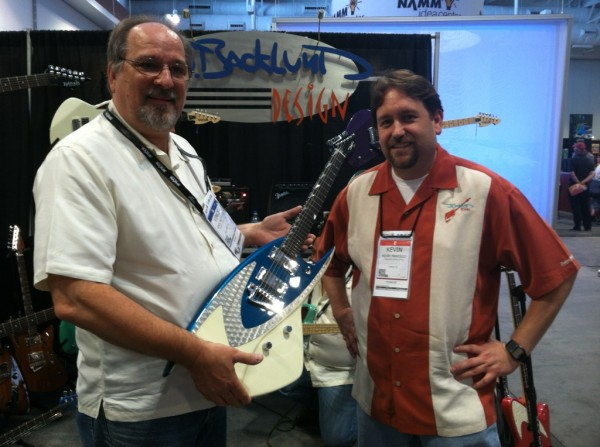 Vince and John Backlund with his JBD-400 design at the 2014 Summer NAMM conference